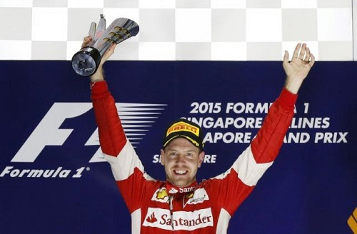 Ferrari Formula One driver Vettel of Germany celebrates on the podium after winning the Singapore F1 Grand Prix