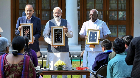 Rs 20 coins unveiled by PM Modi