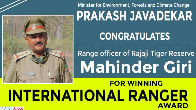 Prakash Javadekar congratulates Mahinder Giri for winning International Ranger Award